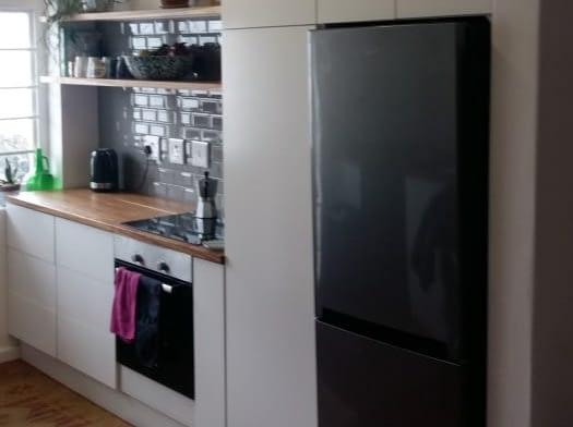 Kitchen Renovation with sprayed doors and Kiaat wooden tops