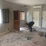 Renovations Stellenbosch Cape Town Removing floor tile for shower area