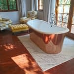 Renovation Stellenbosch Cape Town showing completed installation of Granite slab with copper bath on top.