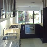 Kitchen Renovation Cape Town after finishing with Wengi melamine and granite tops